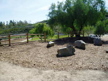 Rock_garden_with_rail_fence_and_boulders_1
